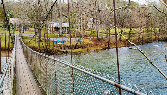 a swinging footbridge over the Little River in Townsend, TN